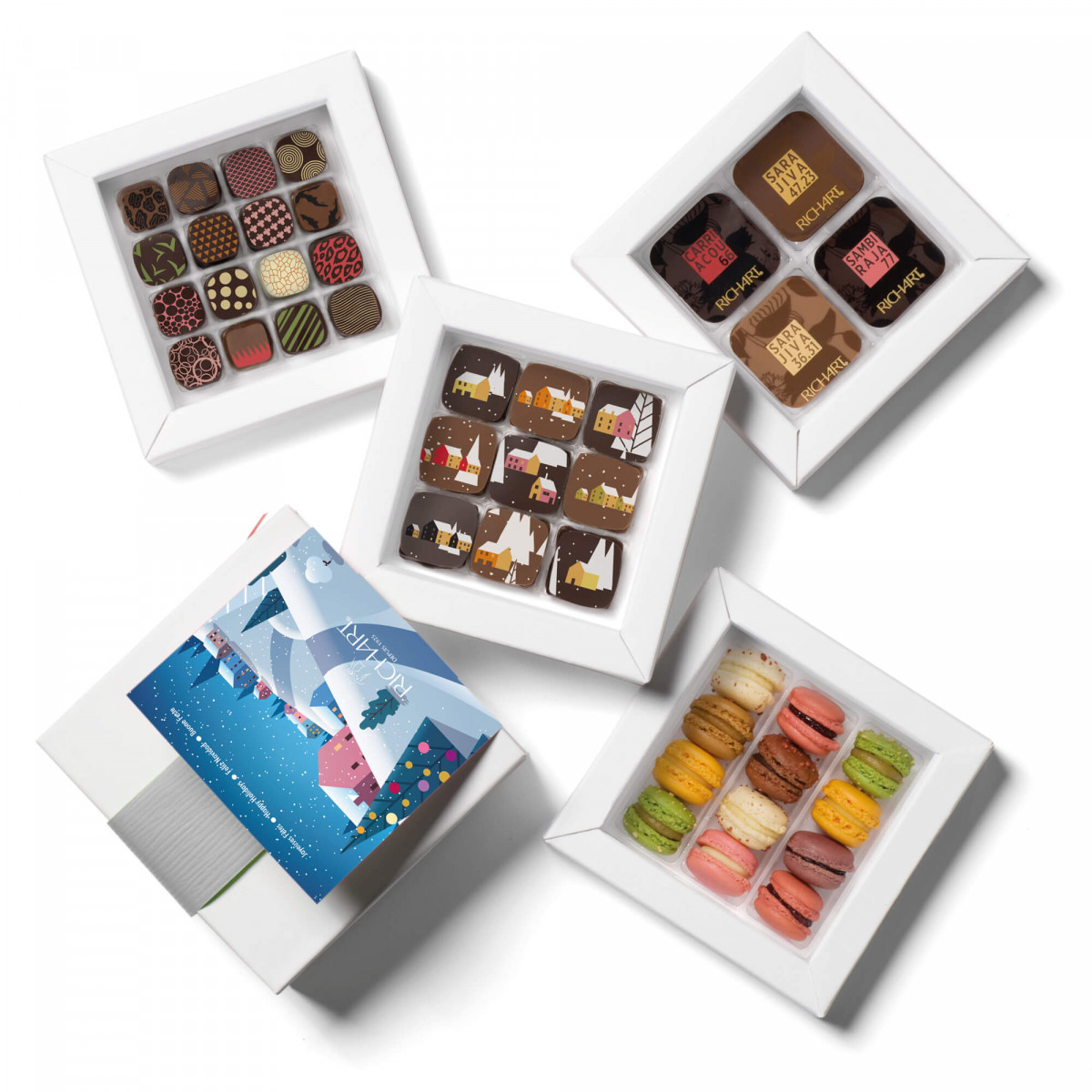 Sparkling Holiday, a gift box of filled chocolates from the new collection, solid chocolates and French mini-macarons.